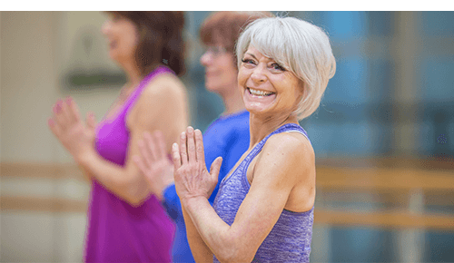 Older Woman Exercising Yoga
