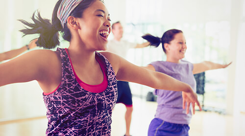 Woman Exercising at Gym