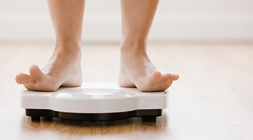 Woman Scale Weight Loss