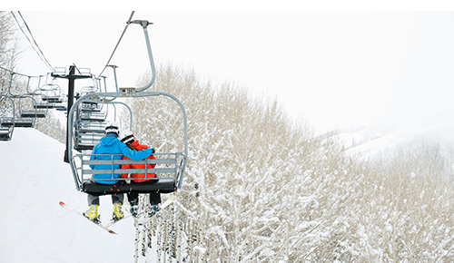 Couple Winter Ski Lift