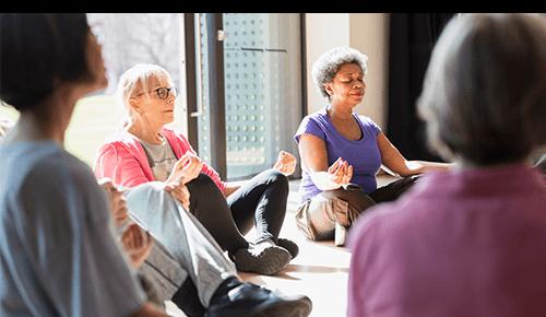 Older Women Practicing Yoga