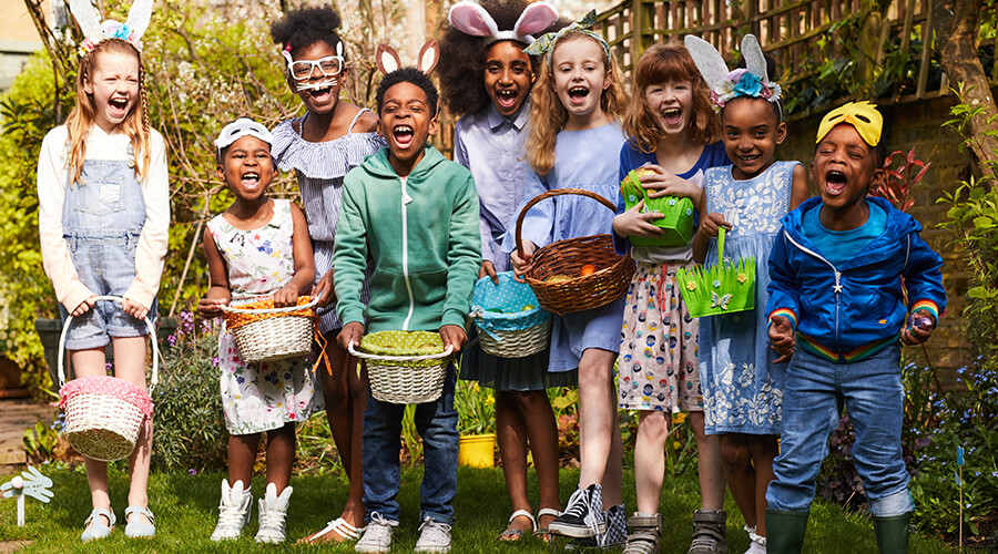 Group of children wearing Easter clothes and holding Easter baskets
