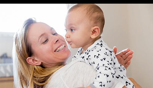 Mother Burping Baby Happy