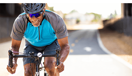 Older Man Cycling for Exercise