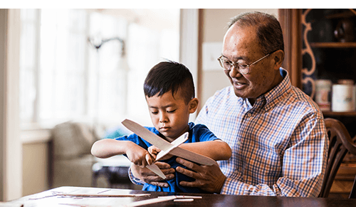 Baby Boomer Grandfather and Grandson