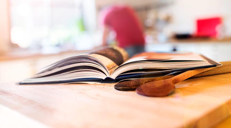 Open cookbook on kitchen counter
