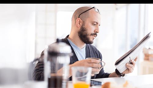 Morning Man Reading Newspaper Drinking Coffee