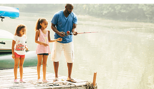 Father and Daughters Fishing
