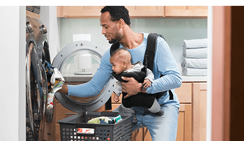 Dad and Baby Household Chores Laundry