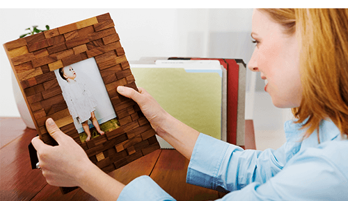 Mom Holding Picture of Baby at Work