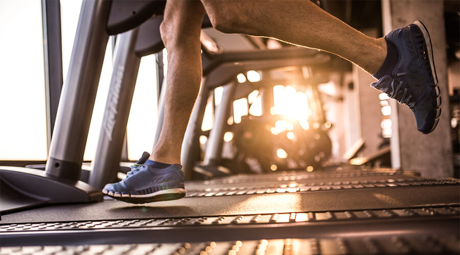 Closeup of person running on a treadmill