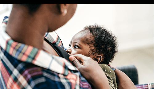 Woman Breastfeeding Her Baby