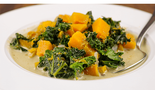 closeup of bowl filled with Butternut Squash, Kale & Quinoa Stew