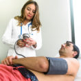 Doctor examining man in doctor's office