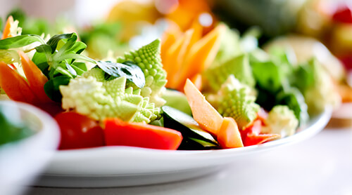 Closeup of cut up vegetables on plate
