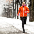 Woman running outside during the winter
