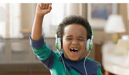 Child listening to music and singing