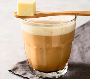 Cup of bulletproof coffee with a spoonful of butter resting on top