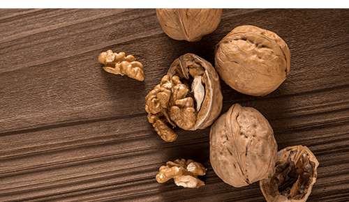 Walnuts in shells sitting on table