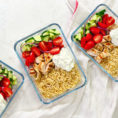 Three glass containers with healthy meals for lunches