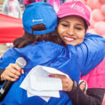 Dr. Deepa Halaharvi hugging another person during a Race for the Cure event