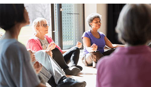 Older Women Practicing Yoga