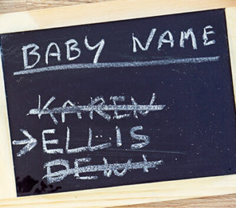 Chalkboard with baby names written on it, one name crossed out