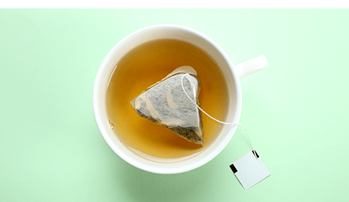 Cup of tea with teabag in liquid