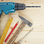 Variety of tools sitting on a wood background