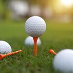 Closeup of golf balls on grass