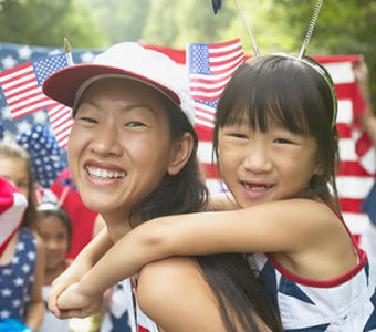 Mother and daughter wearing red, white and blue at a July Fourth celebration parade