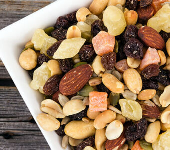 Bowl of trail mix with nuts and dried fruit