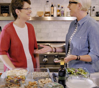 Woman talking to a dietitian in a kitchen