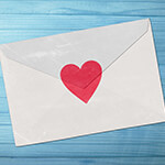 Enveloped closed with a red heart sticker