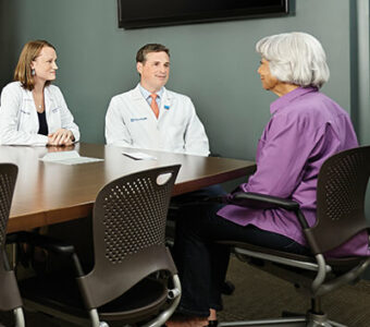 Person talking to two OhioHealth doctors