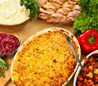 Tabletop with different Thanksgiving dishes and turkey
