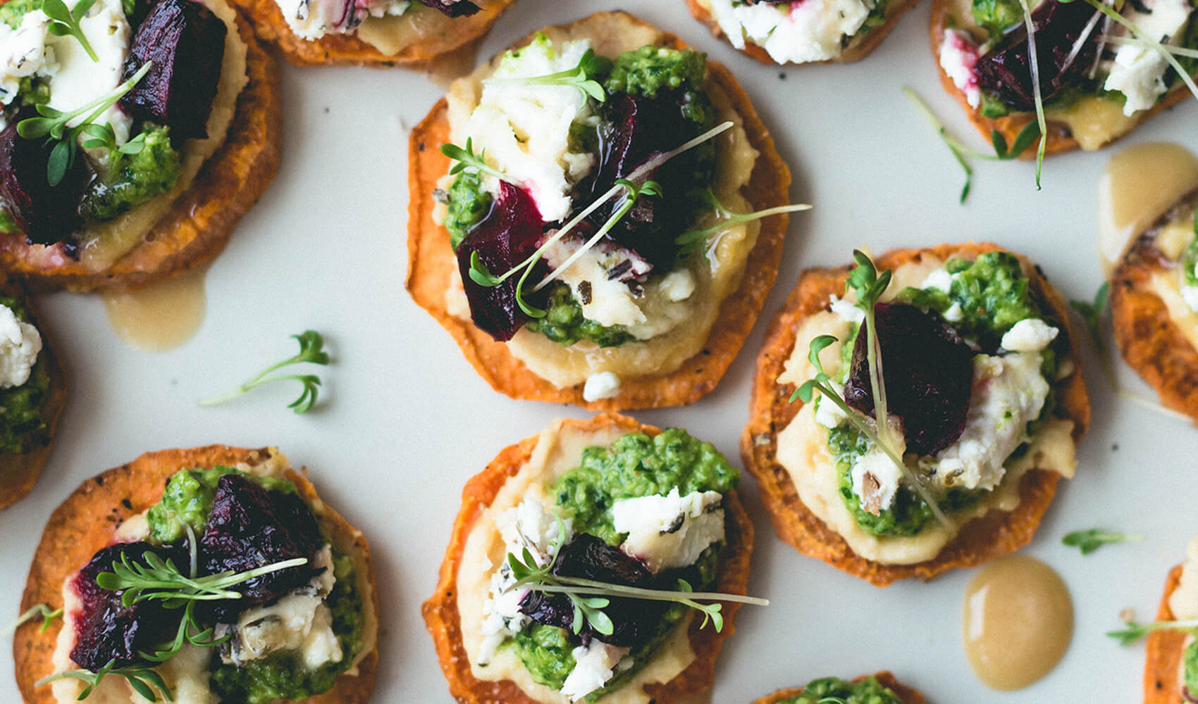 Sweet Potato Rounds with Hummus, Pesto, and Goat Cheese