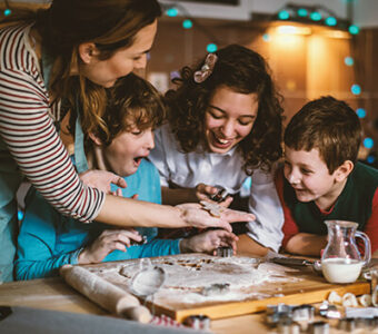 Family baking holiday cookies together