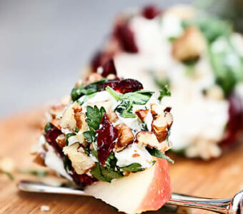 Sliced apples covered with cheese and nuts for appetizer