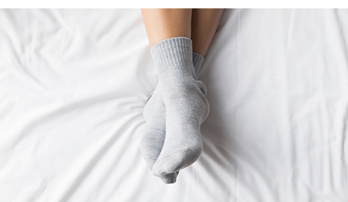 Closeup of pair of feet with socks on