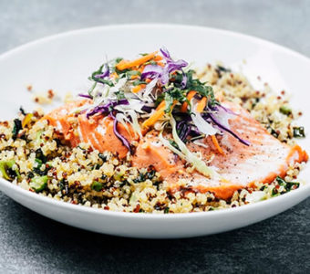 Bowl with grains topped with a filet of salmon