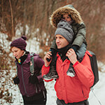 Family hiking in the winter