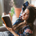Person relaxing and reading a book