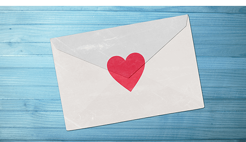 Envelope closed with red heart sticker
