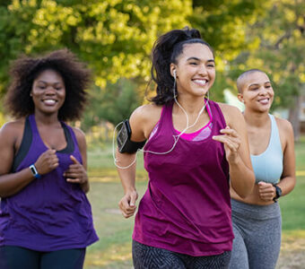 Group of three people running outside