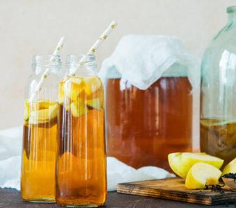 Large jar and small bottles of kombucha tea