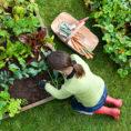 Woman kneeling while working in her garden