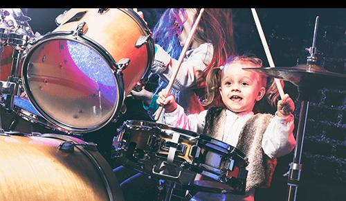 Child playing drum set