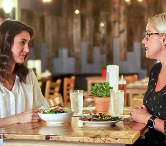 Woman talking to dietitian in restaurant