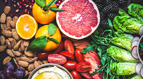 Variety of fruits, vegetables, nuts and hummus